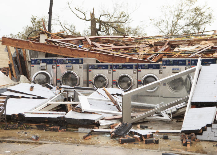 Pousson's Laundromat and Barbershop is left in ruins, Friday, Aug. 28, 2020, in Westlake, La., from Hurricane Laura. (Kirk Meche/American Press via AP)
