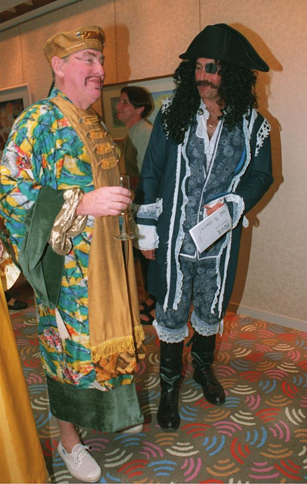 25 DEC 1994:  ENGLANDS CHAIRMAN OF SELECTORS RAY ILLINGWORTH AND GRAHAM GOOCH IN DRESSED UP IN FANCY DRESS FOR THE CHRISTMAS PARTY DURING THE SECOND TEST AGAINST AUSTRALIA IN MELBOURNE. Mandatory Credit: Ben Radford/ALLSPORT