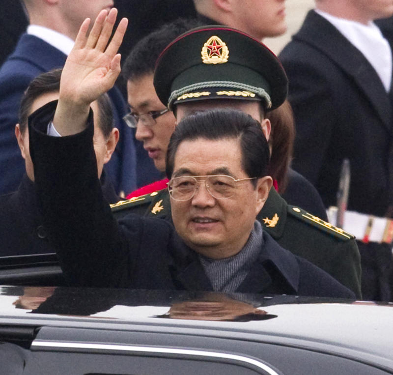 Chinese President Hu Jintao waves after an arrival ceremony, Tuesday, Jan. 18, 2011, at Andrews Air Force Base, Md. (AP Photo/Evan Vucci)