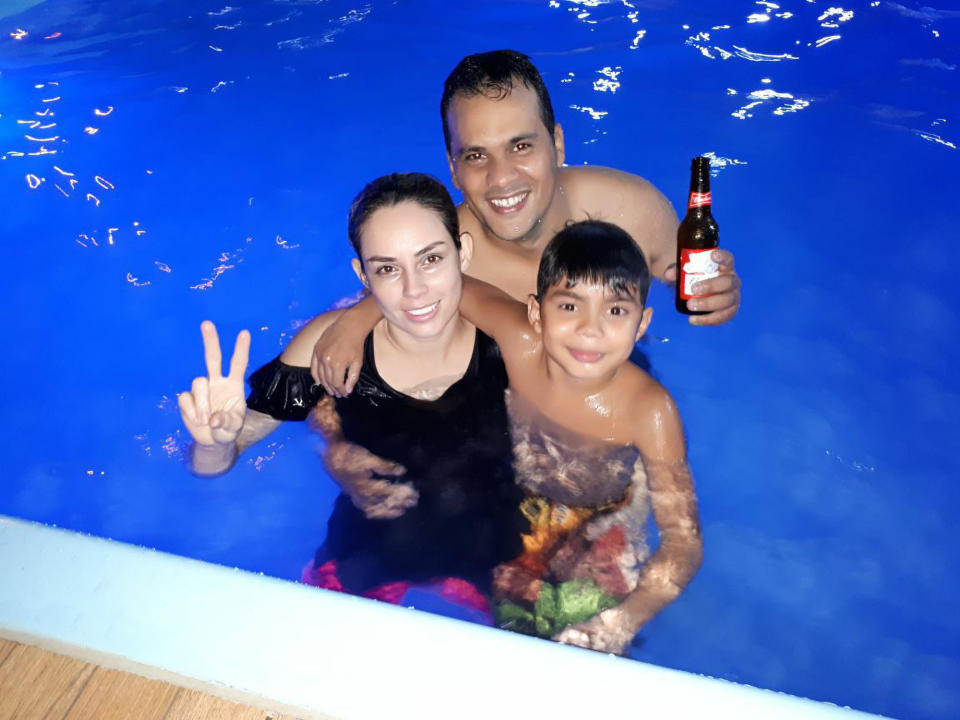 Rodrigo Roa Alvarez, centre, died after being sucked by a hamburger machine in Dourados, Brazil, in a photo with his wife (left) and son (right). Source: Newsflash/Australscope