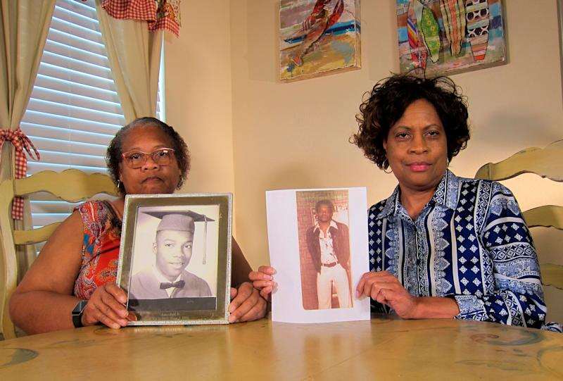 James Byrd Jr's sisters Mylinda Byrd Washington (left) and Louvon Byrd Harris (61) with photographs of their brother (AP Photo/Juan Lozano)