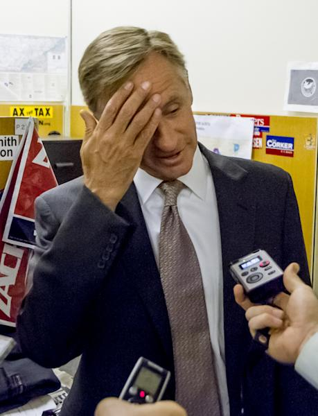 CORRECTS MONTH IN DATE - Gov. Bill Haslam speaks to reporter s during an impromptu visit to the press suite at the legislative office complex in Nashville, Tenn., on Tuesday, April 16, 2013. The Republican governor said he still doesn't know why federal agents searched the Knoxville headquarters of the family-owned Pilot Flying J chain of truck stops. (AP Photo/Erik Schelzig).