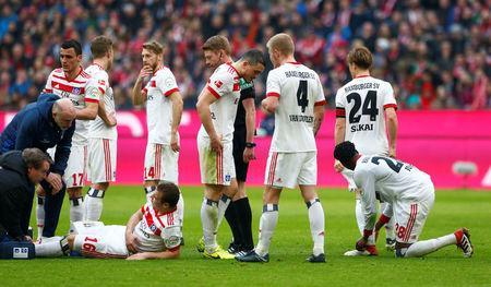 Soccer Football - Bundesliga - Bayern Munich vs Hamburger SV - Allianz Arena, Munich, Germany - March 10, 2018 Hamburg's Vasilije Janjicic receives treatment from the physio after sustaining an injury REUTERS/Michaela Rehle