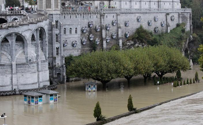 View of basilica of Immacule Conception on the sanctuary of Lourdes flooded, in Lourdes, southwestern France, Saturday, Oct.20,2012. French rescue services and police are evacuating hundreds of pilgrims from hotels threatened by floodwaters from a rain-swollen river in the Roman Catholic shrine town of Lourdes. (AP Photo/Bob Edme)
