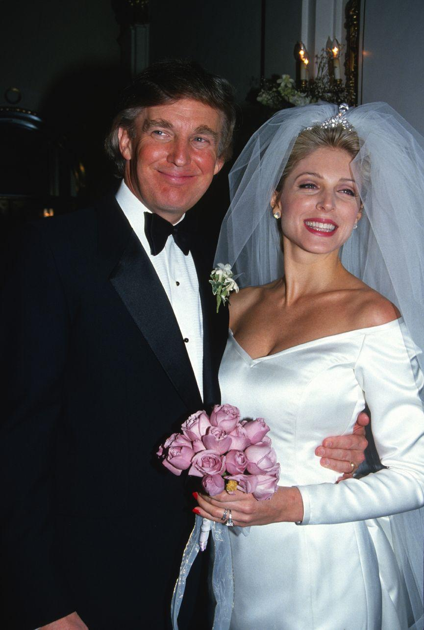 <p>Bridal gowns of the '90s were more sleek and simple than the styles popular in the 1980s, but brides still loved a small touch of poof and drama, which is evident in this photo from the wedding of Marla Maples and Donald Trump. </p>