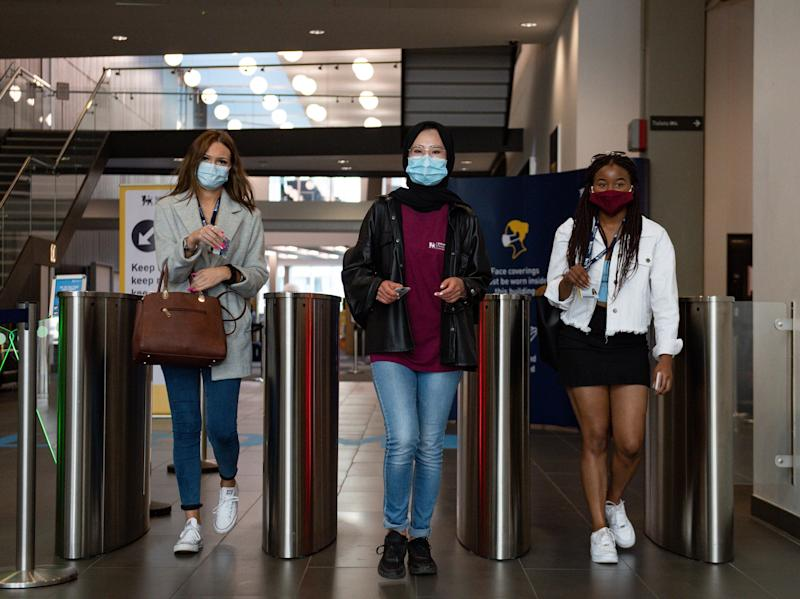 Students at Birmingham City University arrive for the start of term, as thousands prepare to study in socially distanced surroundings. (Jacob King/PA)