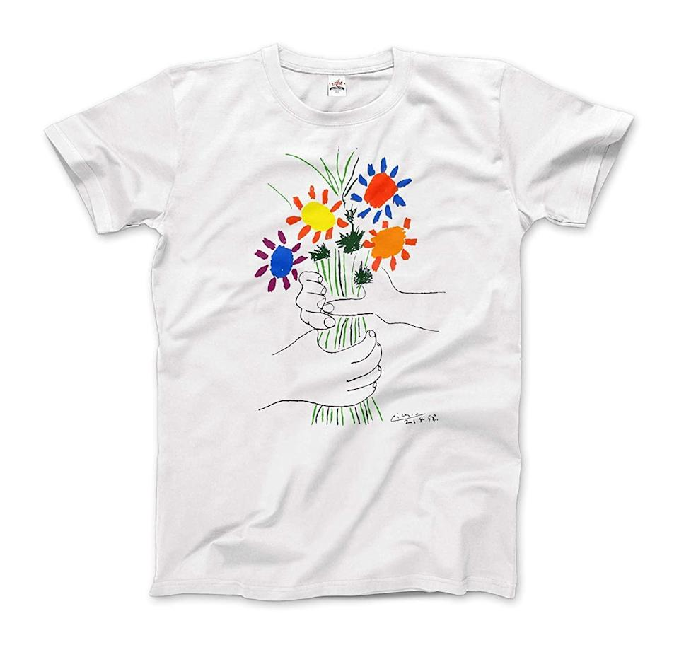 """<h2>Art-o-Rama Pablo Picasso T-Shirt<br></h2><br>A modern-art tee bearing a message that we can all get behind.<br><br><strong>Art-O-Rama</strong> Pablo Picasso T-Shirt, $, available at <a href=""""https://www.amazon.com/Picasso-Bouquet-Artwork-T-Shirt-Sleeve/dp/B08769FTG6/ref=zg_bsms_handmade_10"""" rel=""""nofollow noopener"""" target=""""_blank"""" data-ylk=""""slk:Amazon"""" class=""""link rapid-noclick-resp"""">Amazon</a>"""