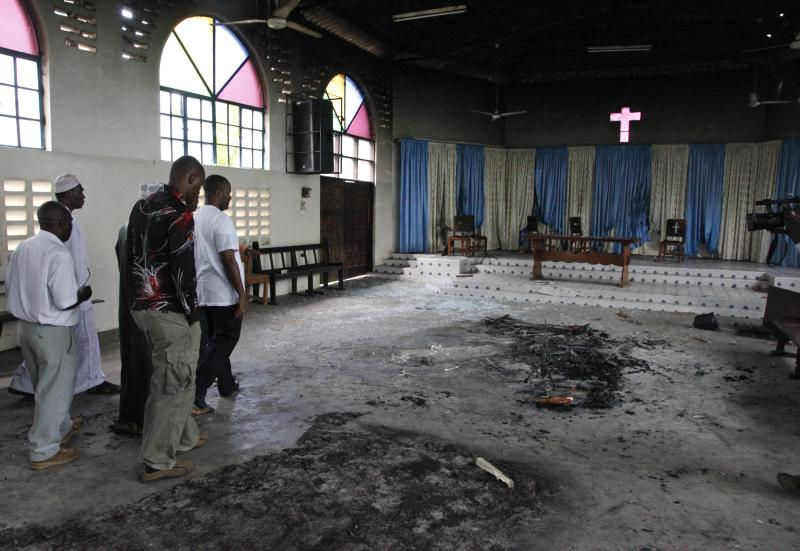 Religious leaders and area member of parliament Ali Hassan Joho, right, visit a church Wednesday, Aug. 29, 2012 in Kisauni north Mombasa, which was destroyed my Muslim youth followed the death of a controversial Muslim preacher Aboud Rogo Mohammed. Muslim cleric Aboud Rogo Mohammed who was sanctioned by the U.S. and U.N. for his alleged support for an al-Qiada-linked militant group, was shot to death by unknown gunmen Monday morning in his car as he drove family members including his five-year-old daughter who was unharmed. (AP Photo/Sayyid Azim)