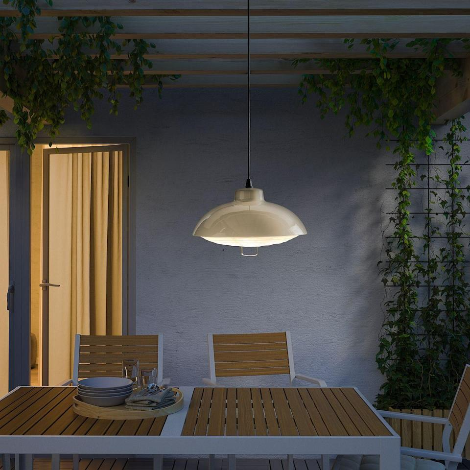 """<p><strong>IKEA</strong></p><p>ikea.com</p><p><strong>$34.99</strong></p><p><a href=""""https://www.ikea.com/us/en/p/solvinden-led-solar-powered-pendant-lamp-outdoor-beige-10484573/"""" rel=""""nofollow noopener"""" target=""""_blank"""" data-ylk=""""slk:Shop Now"""" class=""""link rapid-noclick-resp"""">Shop Now</a></p><p>If you're hoping for a polished, modern look, this fixture is for you. This pendant lamp looks like it would need to be professionally installed, but it's actually solar powered and can be hung from anywhere.</p>"""