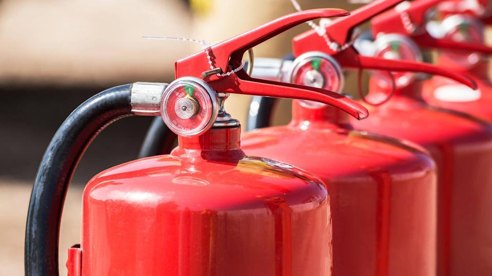 Red tank of fire extinguisher. Overview of a powerful industrial fire extinguishing system. Emergency equipment for industrial refinery crude oil and gas.compressed gas carbon dioxide in side. Fire
