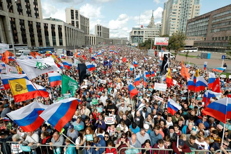 More than 22,000 people crowded a Moscow square on Saturday, the largest such demonstration in years