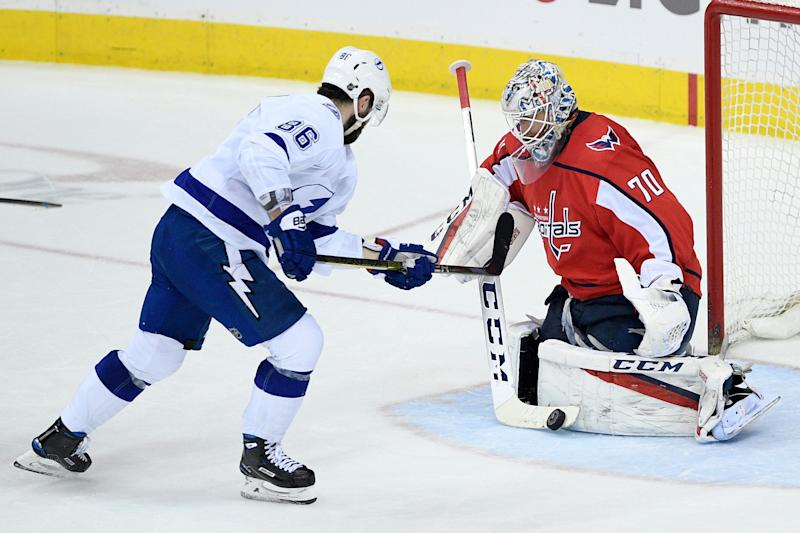 Washington Capitals goaltender Braden Holtby (70) stops the puck in front of Tampa Bay Lightning right wing Nikita Kucherov (86), of Russia, during the third period of an NHL hockey game, Wednesday, March 20, 2019, in Washington. The Lightning won 5-4 in overtime. (AP Photo/Nick Wass)
