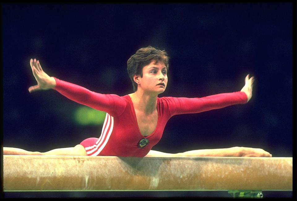<p>Yelena Shushunova of the Soviet Union performs at the 1988 Seoul Olympics. (Getty Images) </p>