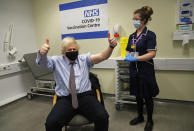Britain's Prime Minister Boris Johnson gestures after receiving the first dose of the AstraZeneca vaccine administered by nurse and Clinical Pod Lead, Lily Harrington at St.Thomas' Hospital in London, Friday, March 19, 2021. Johnson is one of several politicians across Europe, including French Prime Minister Jean Castex, getting a shot of the AstraZeneca vaccine on Friday. (AP Photo/Frank Augstein, Pool)