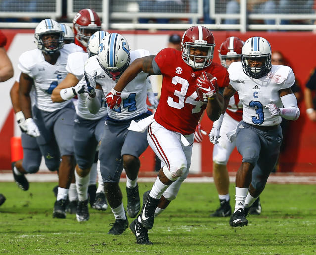 Alabama running back Damien Harris (34) carries the ball against Citadel during the second half of an NCAA college football game, Saturday, Nov. 17, 2018, in Tuscaloosa, Ala. (AP Photo/Butch Dill)