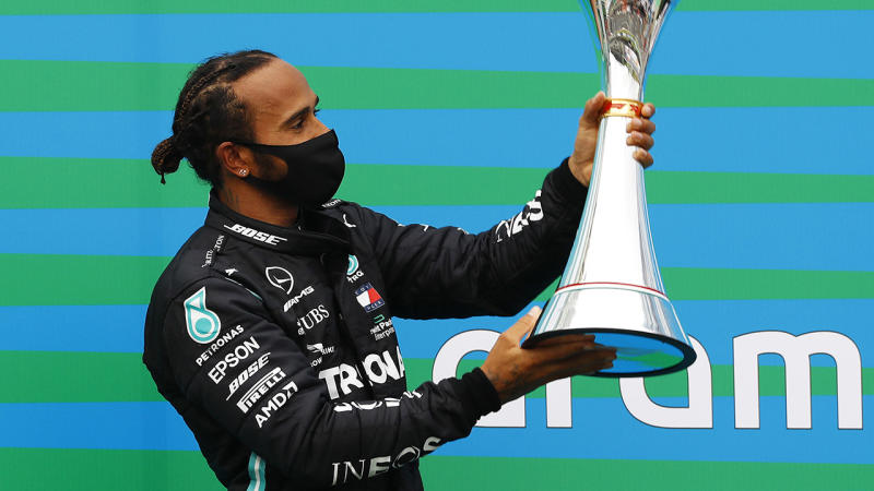 Lewis Hamilton, pictured here on the podium after winning the Hungarian Grand Prix.