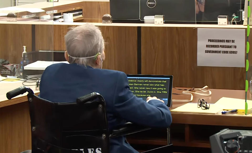 In this still image taken from the Law&Crime Network court pool video, real estate heir Robert Durst looks at a statement on an electronic device as Deputy District Attorney John Lewin, presents a new round of opening statements in the murder case against Durst after a 14-month recess due to the coronavirus pandemic in Los Angeles County Superior Court in Inglewood, Calif., Tuesday, May 18, 2021. Durst, 78, an heir to a New York commercial real estate empire, is charged with first-degree murder in the slaying of his best friend, Susan Berman. (Law&Crime Network via AP, Pool)