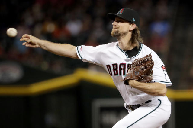 FILE - In this Sept. 24, 2019, file photo, Arizona Diamondbacks starting pitcher Mike Leake throws against the St. Louis Cardinals during the first inning of a baseball game, in Phoenix. Diamondbacks right-hander Mike Leake has opted out of the 2020 season due to concerns about the coronavirus. Diamondbacks general manager Mike Hazen did not elaborate on Leakes decision during a Zoom call, but the pitchers agent issued a statement saying he made a personal decision not to play during the pandemic. (AP Photo/Matt York, File)