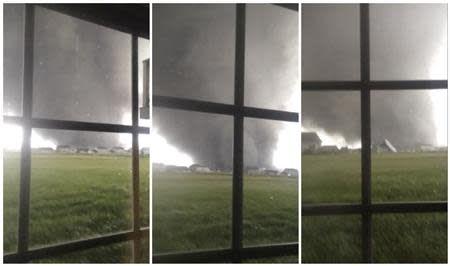 An active tornado is seen through a window as it touches down in Washington, Illinois on November 17, 2013, in this combination of three still images captured from a video courtesy of Anthony Khoury. REUTERS/Anthony Khoury/Handout via Reuters