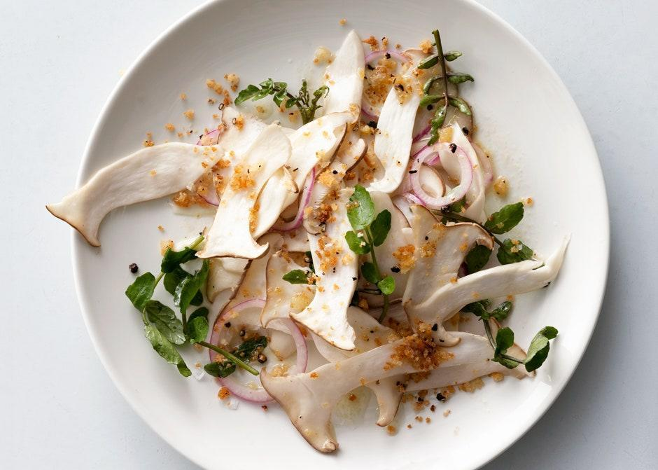 "King trumpet mushrooms star in this salad served at Brooklyn's Prime Meats. They're available at many supermarkets, but you'll find them at better prices at many Asian markets. Crimini (baby bella) mushrooms are a fine substitute. <a href=""https://www.bonappetit.com/recipe/mushroom-and-watercress-salad-with-breadcrumbs?mbid=synd_yahoo_rss"" rel=""nofollow noopener"" target=""_blank"" data-ylk=""slk:See recipe."" class=""link rapid-noclick-resp"">See recipe.</a>"