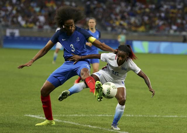 <p>Crystal Dunn (USA) of U.S. and Wendi Renard (FRA) of France in action. REUTERS/Mariana Bazo </p>