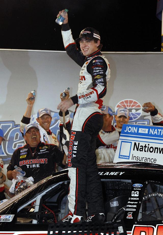 Ryan Blaney celebrates after winning the NASCAR Nationwide Series auto race, Saturday, Sept. 21, 2013, at Kentucky Motor Speedway in Sparta, Ky. (AP Photo/James Crisp)