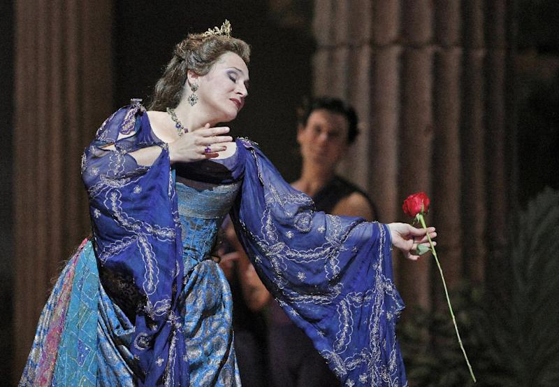 """This undated publicity photo provided by the San Francisco Opera shows soprano Patricia Racette as Elena in Act IV during the dress rehearsal of """"Mefistofele,"""" in San Francisco. (AP Photo/Copyright San Francisco Opera, Cory Weaver)"""