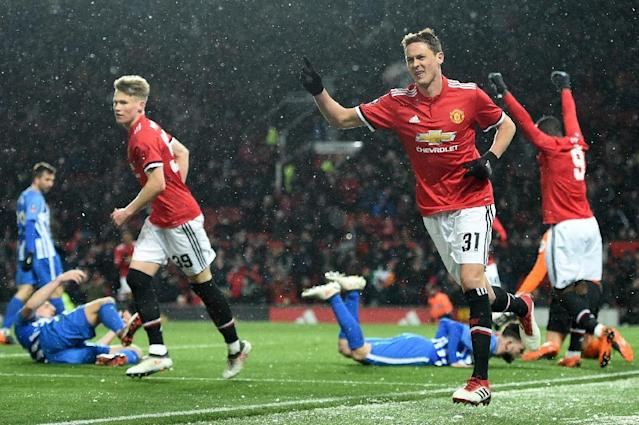 Nemanja Matic scored a goal and set up the other as Manchester United beat Brighton to reach the last four of the FA Cup (AFP Photo/Oli SCARFF )