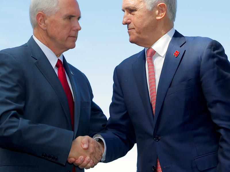 Mike Pence shook hands with Prime Minister Malcolm Turnbull after announcing a US commitment to the refugee resettlement deal: REUTERS