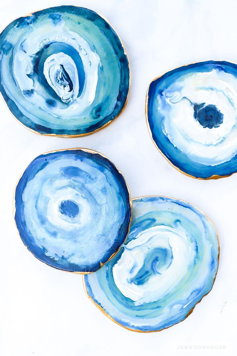"""<p>These coasters couldn't be more gorgeous. It's hard to believe they're made of polymer clay and a bit of acrylic paint—making them a beautiful <em>and</em> inexpensive DIY gift.</p><p><strong>Get the tutorial at <a href=""""https://jenwoodhouse.com/diy-agate-coasters/"""" rel=""""nofollow noopener"""" target=""""_blank"""" data-ylk=""""slk:The House of Wood"""" class=""""link rapid-noclick-resp"""">The House of Wood</a>.</strong></p><p><strong><a class=""""link rapid-noclick-resp"""" href=""""https://www.amazon.com/Liquitex-BASICS-Acrylic-Paint-Primary/dp/B004IXDBZG?tag=syn-yahoo-20&ascsubtag=%5Bartid%7C10050.g.645%5Bsrc%7Cyahoo-us"""" rel=""""nofollow noopener"""" target=""""_blank"""" data-ylk=""""slk:SHOP BLUE PAINT"""">SHOP BLUE PAINT</a></strong></p>"""