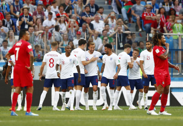 England's Harry Kane, centre, is congratulated by teammates after scoring his team's sixth goal during the group G match between England and Panama at the 2018 soccer World Cup at the Nizhny Novgorod Stadium in Nizhny Novgorod , Russia, Sunday, June 24, 2018. (AP Photo/Matthias Schrader)