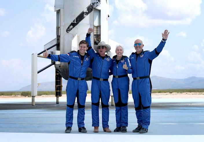 Blue Origin's New Shepard crew (L-R) Oliver Daemen, Jeff Bezos, Wally Funk and Mark Bezos pose for a picture after flying into space in the Blue Origin New Shepard in Van Horn, Texas (Getty Images)