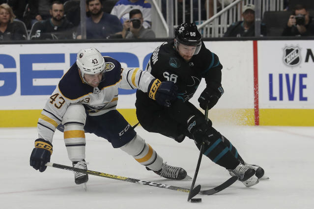 San Jose Sharks center Melker Karlsson (68) skates with the puck in front of Buffalo Sabres left wing Conor Sheary (43) during the first period of an NHL hockey game in San Jose, Calif., Saturday, Oct. 19, 2019. (AP Photo/Jeff Chiu)