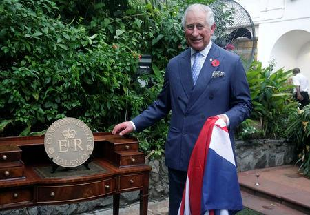 Britain's Prince Charles stands by a Commonwealth Walkway plaque, during a reception at the Deputy High Commissioner's Residence in Lagos, Nigeria, November 7, 2018. Sunday Alamba/Pool via Reuters