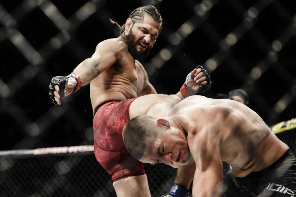 Jorge Masvidal, left, kicks Nate Diaz during the first round of a welterweight mixed martial arts bout at UFC 244 early Sunday, Nov. 3, 2019, in New York. Masvidal stopped Diaz in the fourth round. (AP Photo/Frank Franklin II)