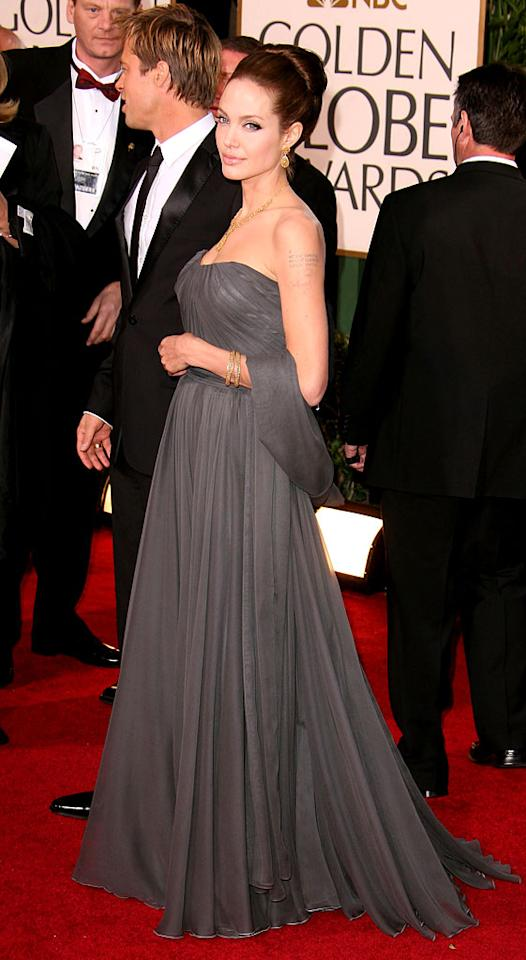 """<a href=""""/brad-pitt/contributor/28425"""">Brad Pitt</a> and Angelina Jolie at <a href=""""/the-64th-annual-golden-globe-awards/show/40075"""">the 64th annual Golden Globe Awards</a>."""