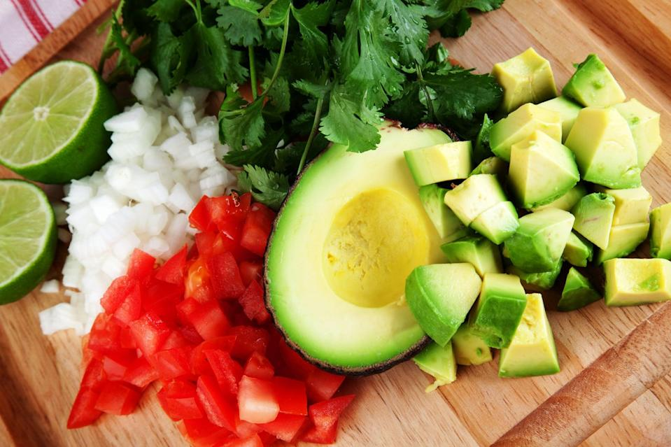 Diced avocado tomato onion.THIS IMAGE IS ONLY AVAILABLE HERE AT ISTOCKPHOTO