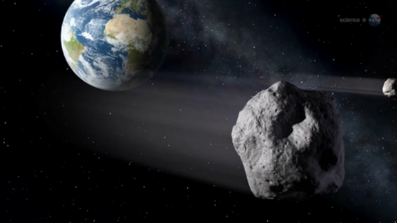 An artist's conception of the Feb. 15 flyby of asteroid 2012 DA14.
