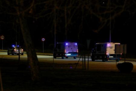 Police vans, believed to carry Catalan separatist politicians, leave prison on their to way to the Supreme Court in Soto del Real, Spain, February 12, 2019. REUTERS/Juan Medina
