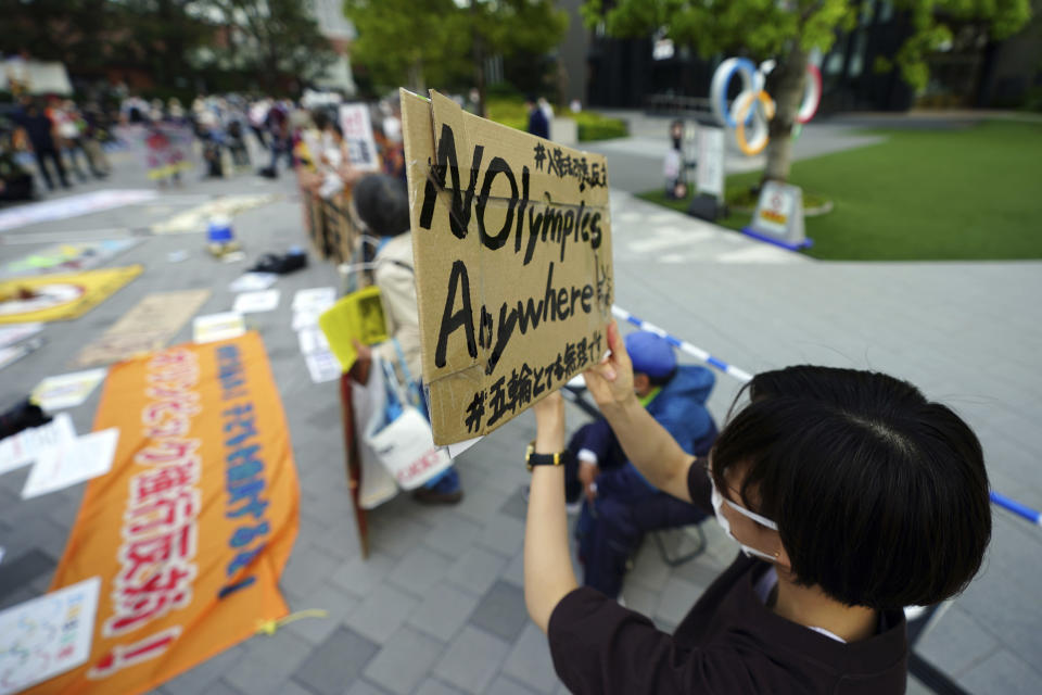 People against the Tokyo 2020 Olympics set to open in July, protest around Tokyo's National Stadium during the anti-Olympics demonstration Sunday, May 9, 2021. (AP Photo/Eugene Hoshiko)