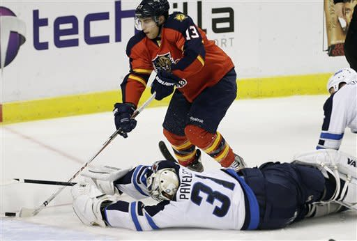 Winnipeg Jets goalie Ondrej Pavelec (31) is unable to stop Florida Panthers' Mike Santorelli (13) from scoring a goal during the third period of an NHL hockey game in Sunrise, Fla., Tuesday, March 5, 2013. The Panthers won 4-1. (AP Photo/J Pat Carter)