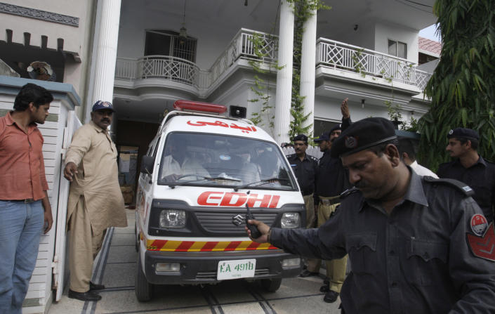 """An ambulance removes dead bodies of shooting victims from a house in Lahore, Pakistan on Monday, April 30, 2012. The widow and mother-in-law of one of two Pakistanis men shot and killed by a CIA contractor last year, have been murdered in Lahore, police said. It appears the killings may have been related to the large amount of """"blood money"""" Zohra Haider received to pardon her husband's killer, Raymond Davis. (AP Photo/K.M. Chaudary)"""