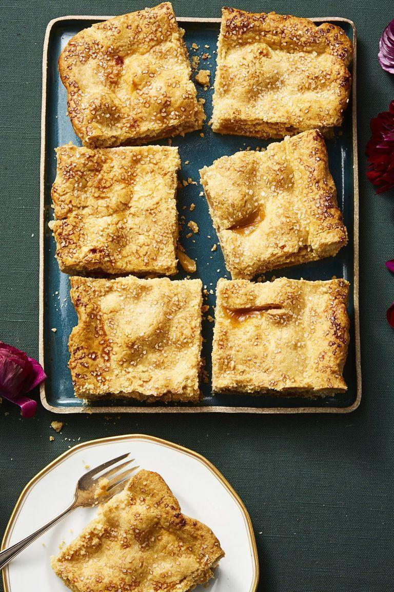 "<p>Who says apple pies have to be round? We turned the fall classic into a sheet pan masterpiece, then topped the whole thing with coarse turbinado sugar for a delicious shimmer.</p><p><em><a href=""https://www.goodhousekeeping.com/food-recipes/a14801/sparkly-apple-slab-pie-recipe-ghk1114/"" rel=""nofollow noopener"" target=""_blank"" data-ylk=""slk:Get the recipe for Sparkly Apple Slab Pie »"" class=""link rapid-noclick-resp"">Get the recipe for Sparkly Apple Slab Pie »</a></em> </p>"
