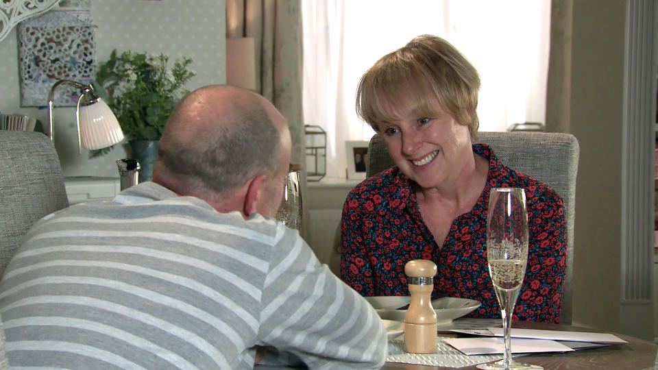 FROM ITV  STRICT EMBARGO - No Use Before Tuesday Tuesday 28th September 2021  Coronation Street - Ep 10448  Wednesday 6th October 2021 - 1st Ep  Sally Metcalfe [SALLY DYNEVOR] and Tim Metcalfe [JOE DUTTINE] celebrate their first anniversary. But the occasion is swiftly forgotten when a thrilled Sally opens a letter saying the council is considering her parking proposals.   Picture contact David.crook@itv.com   This photograph is (C) ITV Plc and can only be reproduced for editorial purposes directly in connection with the programme or event mentioned above, or ITV plc. Once made available by ITV plc Picture Desk, this photograph can be reproduced once only up until the transmission [TX] date and no reproduction fee will be charged. Any subsequent usage may incur a fee. This photograph must not be manipulated [excluding basic cropping] in a manner which alters the visual appearance of the person photographed deemed detrimental or inappropriate by ITV plc Picture Desk. This photograph must not be syndicated to any other company, publication or website, or permanently archived, without the express written permission of ITV Picture Desk. Full Terms and conditions are available on  www.itv.com/presscentre/itvpictures/terms