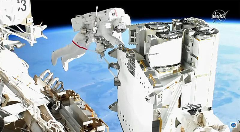 French astronaut Thomas Pesquet works to unbolt a set of roll-out solar arrays so they could be moved to the far left end of the International Space Station's power truss for installation.  / Credit: NASA TV