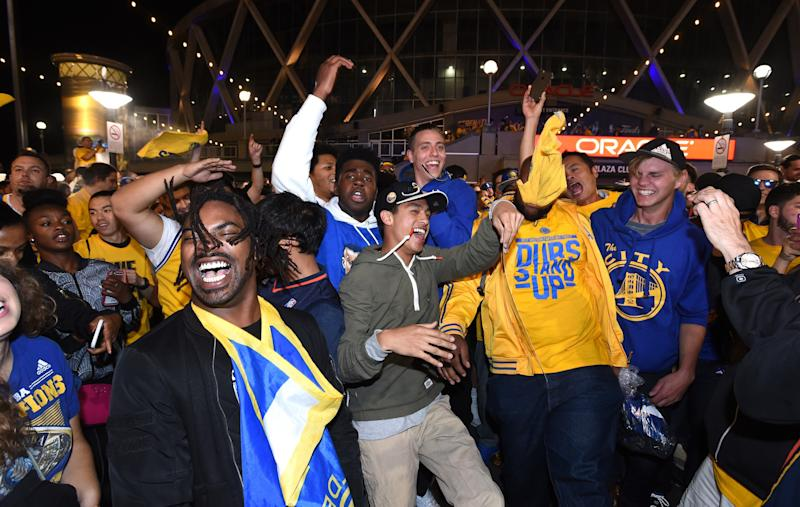 Warriors fans celebrate the team's win in Game 5 of the 2017 NBA Finals to clinch the 2017 NBA championship. (AP)
