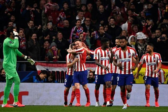 Atletico Madrid's Saul Niguez (C) celebrates scoring an early goal against Liverpool at the Wanda Metropolitano on Tuesday. (AFP Photo/PIERRE-PHILIPPE MARCOU)