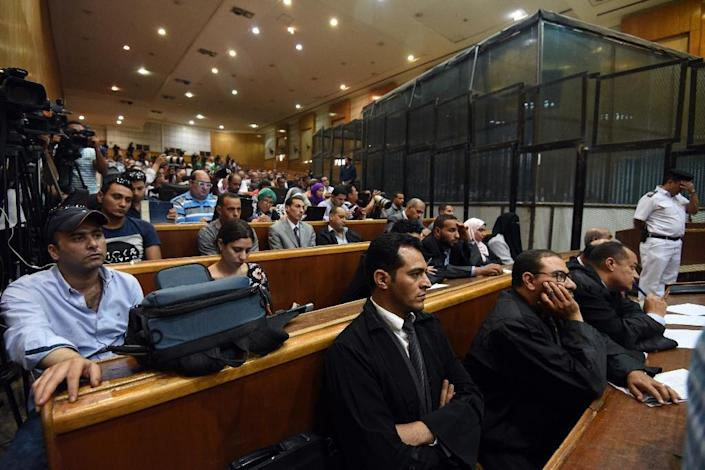 Egyptian police and lawyers attend ousted Islamist president Mohamed Morsi's trial on espionage charges at a court in Cairo on June 18, 2016 (AFP Photo/Mohamed el-Shahed)