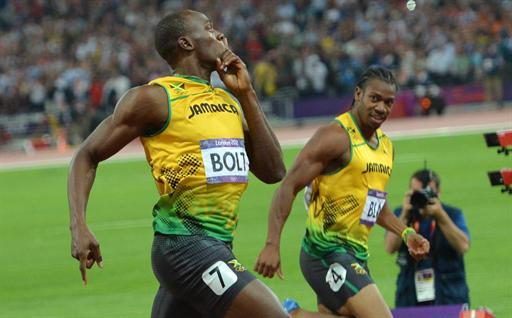 Jamaica's Usain Bolt (L) celebrates with Jamaica's Yohan Blake after competing in the men's 200m final at the athletics event during the London 2012 Olympic Games on August 9, 2012 in London.  AFP PHOTO / JOHANNES EISELE