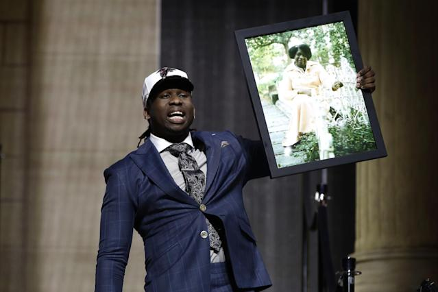 Takkarist McKinley carried a photo of his grandmother onto the stage after being drafted by Atlanta. (AP)